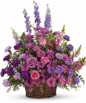 A basket overflowing with pretty flowers.