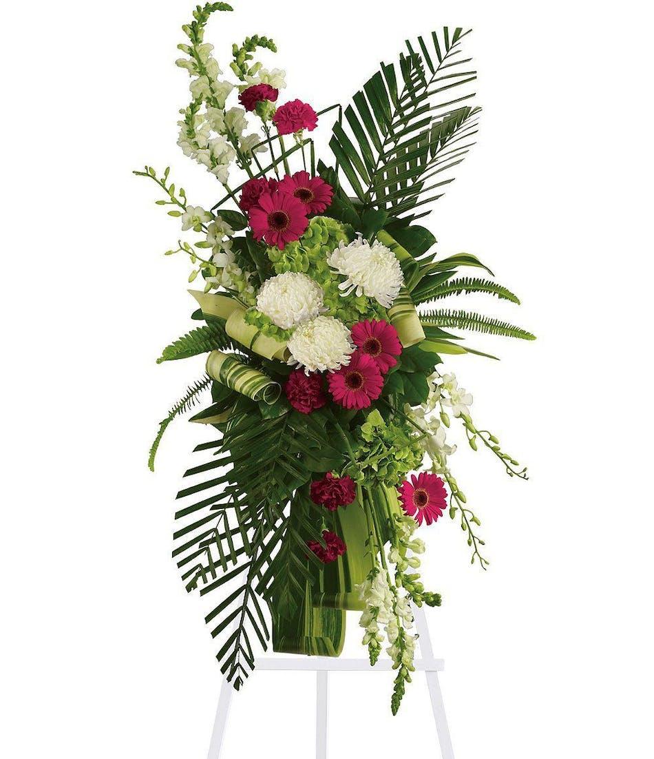 Gerberas and palms spray vogts flowers flint florist izmirmasajfo