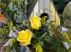 A lovely arrangement of yellow roses